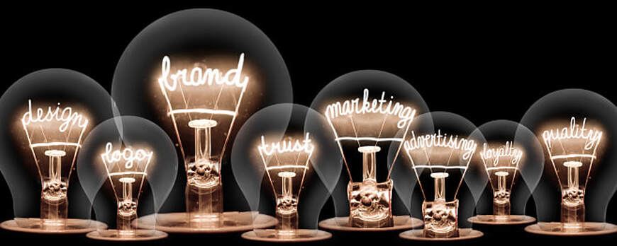 Photo of vintage light bulbs with BRAND and MARKETING concept related words on black background